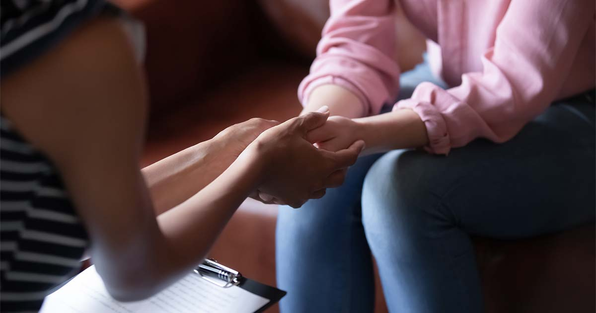 psychologist-holds-hands-of-female-patient